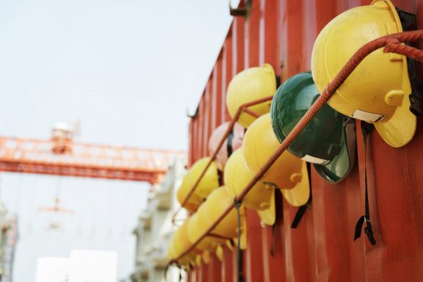Closeup of variety of safety helmets row at construction site